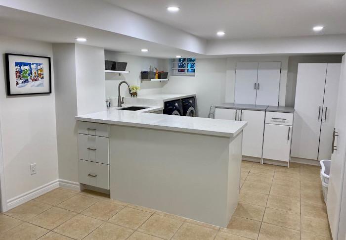white basement mini kitchen