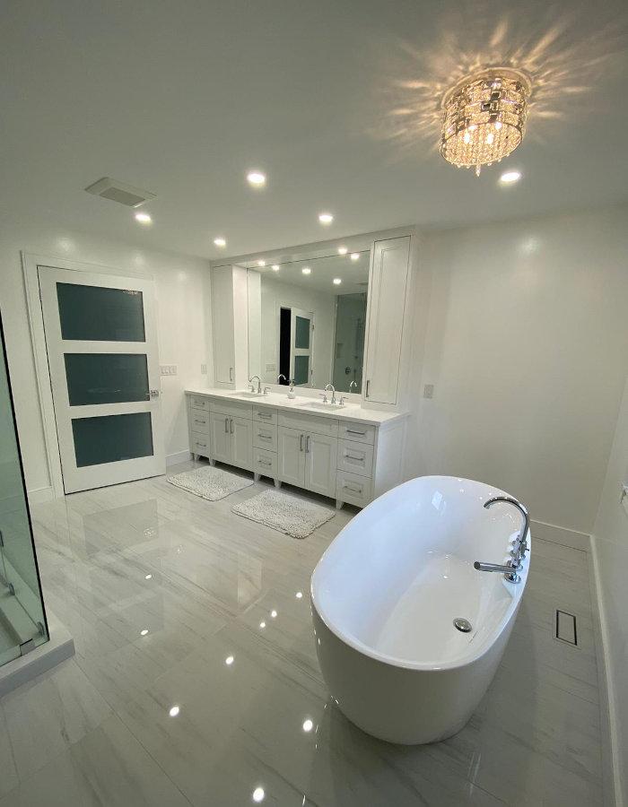 white bathroom bathtub and dual sink
