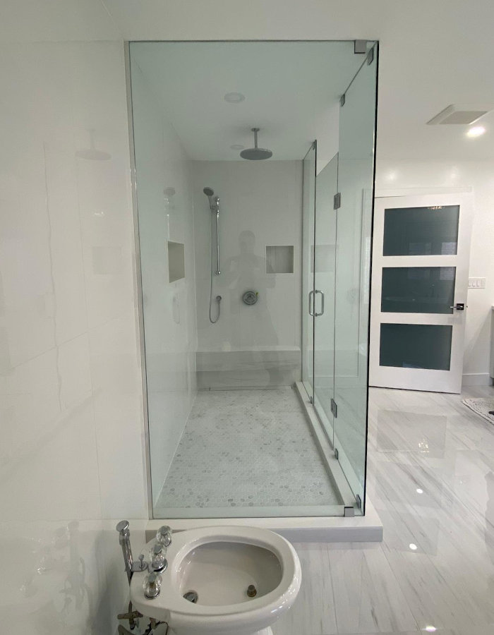 white bathroom toilet and shower