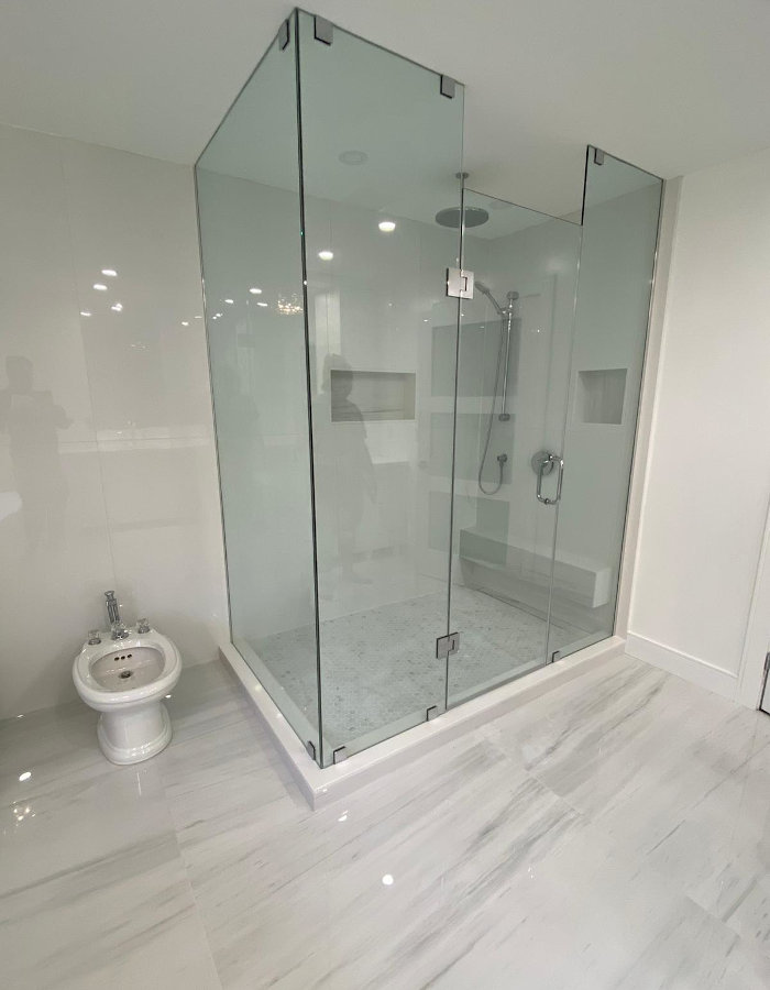 white bathroom shower and toilet