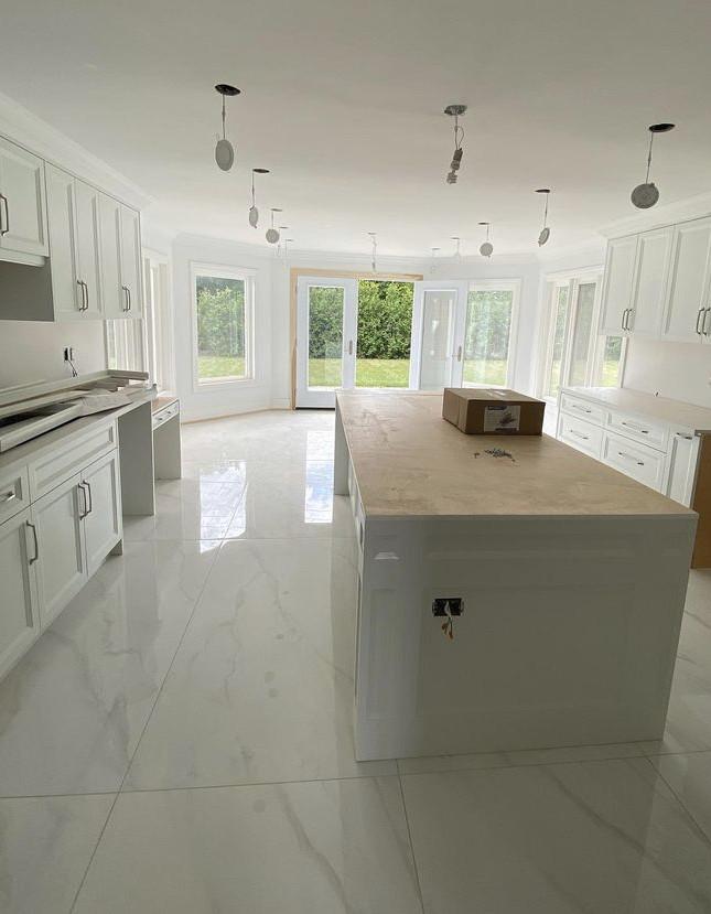 white kitchen with marble floor